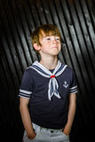 Schoolboy posing in sailor costume with emotions. Studio shooting Stock Image