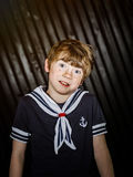 Schoolboy posing in sailor costume with emotions. Studio shooting Royalty Free Stock Photo