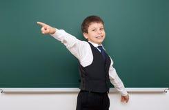 Schoolboy posing at school board, empty space, education concept Stock Photo