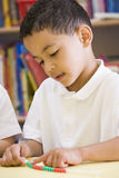A schoolboy in a primary class Stock Image