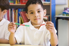 A schoolboy in a primary class Stock Photos