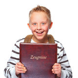Schoolboy proud of his school certificate Royalty Free Stock Photo