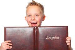 Schoolboy proud of his school certificate Stock Image