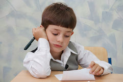 Schoolboy is reading... Stock Images