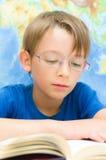 Schoolboy reading Stock Photography