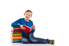 Schoolboy reading book Royalty Free Stock Image