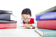Schoolboy reading books seriously Stock Images