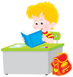 Schoolboy reading a textbook. Vector illustration of a school student sitting at the desk and reading a textbook at lesson in class Stock Photos