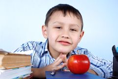 Schoolboy with red apple Stock Photos