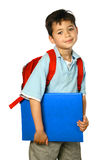 Schoolboy with red rucksack. Young schoolboy of mix ethnicity with red rucksack and blue folder, isolated on white Royalty Free Stock Image