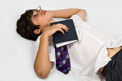 Schoolboy relaxing with book Stock Photo