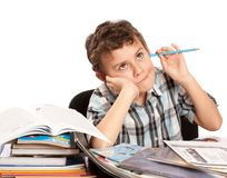 Schoolboy reluctant to doing homework royalty free stock image