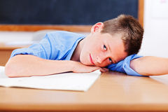 Schoolboy resting in classroom Royalty Free Stock Photos
