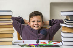 Schoolboy resting during homework. Happy. Stock Images