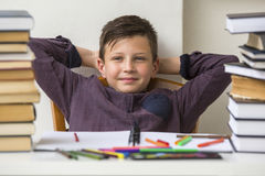 Schoolboy resting during homework time. Relax. Stock Images