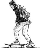Schoolboy rides on a skateboard Stock Photo
