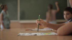 Schoolboy rise hand in classroom. Elementary school. Education stock footage
