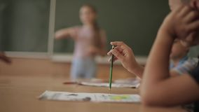 Schoolboy rise hand in classroom. Elementary school. Education stock footage
