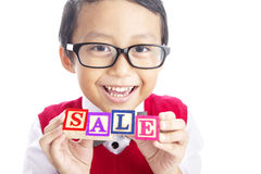 Schoolboy with SALE word Stock Image