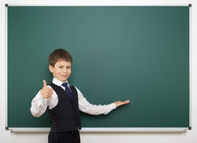 Schoolboy and the school board Stock Photos