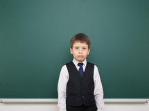 Schoolboy and the school board Royalty Free Stock Image
