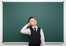Schoolboy and the school board Royalty Free Stock Images