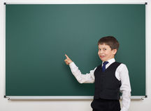 Schoolboy and the school board Royalty Free Stock Photo
