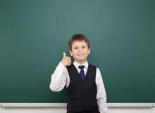 Schoolboy and the school board Royalty Free Stock Photos