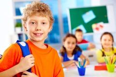 Schoolboy in school Stock Images