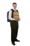 The schoolboy in a school uniform with a huge pack Royalty Free Stock Photography