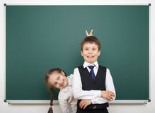 Schoolboy and schoolgirl near the school board Royalty Free Stock Image