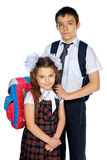 Schoolboy and schoolgirl  with school bags Royalty Free Stock Image