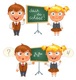 Schoolboy and schoolgirl standing at the blackboard. Back to sch. Back to school. Schoolboy and schoolgirl standing at the blackboard. Funny cartoon character Stock Image
