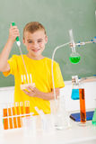 Schoolboy science class Royalty Free Stock Images