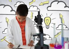 Schoolboy scientist writing with microscope and light bulb idea. Digital composite of Schoolboy scientist writing with microscope and light bulb idea Royalty Free Stock Image