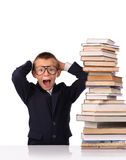 Schoolboy screaming near the huge stack of books Stock Photography