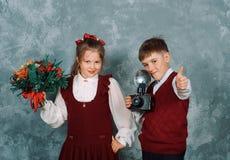 Schoolboy shoots a vintage camera student Stock Images