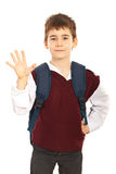 Schoolboy showing five fingers Royalty Free Stock Image