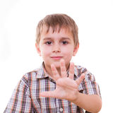 Schoolboy showing numbers with hand Royalty Free Stock Images