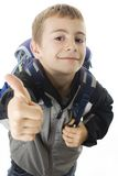 Schoolboy showing OK sign Royalty Free Stock Photography