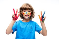 Schoolboy showing painted fingers isolated. On white royalty free stock photos