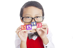 Schoolboy showing SALE word Royalty Free Stock Photos