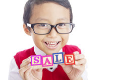 Schoolboy showing SALE word Royalty Free Stock Image