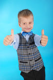 Schoolboy showing two thumbs up Stock Photography