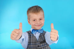 Schoolboy showing two thumbs up Royalty Free Stock Photos