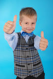 Schoolboy showing two thumbs up Royalty Free Stock Image