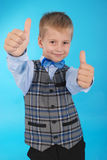 Schoolboy showing two thumbs up Stock Image