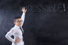 Schoolboy shows impossible word became possible stock photo
