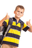 Schoolboy sitting on books Royalty Free Stock Photo