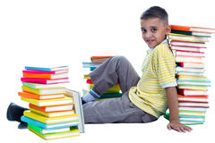 Schoolboy sitting on the flor Stock Images